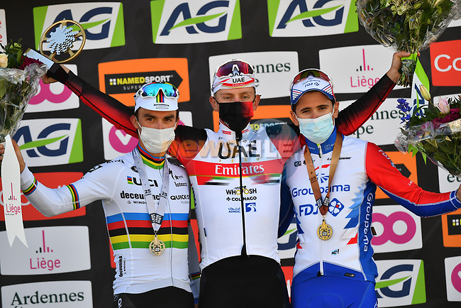 Tadej Pogacar (SLO) UAE Team Emirates wins with World Champion Julian Alaphilippe (FRA) Deceuninck-QuickStep in 2nd place and David Gaudu (FRA) Groupama-FDJ 3rd on the podium at the end of the 107th edition of Liege-Bastogne-Liege 2021, running 259.1km from Liege to Liege, Belgium. 25th April 221.  <br /> Picture: Serge Waldbillig | Cyclefile<br /> <br /> All photos usage must carry mandatory copyright credit (© Cyclefile | Serge Waldbillig)