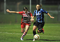 20131001 - VARSENARE , BELGIUM :  Antwerp Angelique De Wulf (left) pictured in front of Brugge's Jody Vangheluwe (right) during the female soccer match between Club Brugge Vrouwen and Royal Antwerp FC Ladies , of the fifth matchday in the BENELEAGUE competition. Tuesday 1 October 2013. PHOTO DAVID CATRY