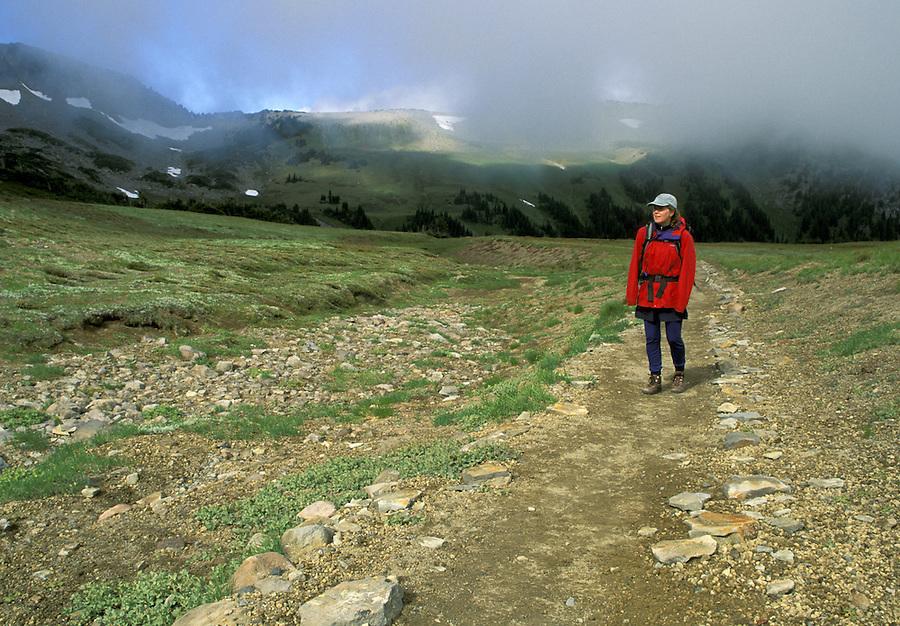 Woman hiking on trail, Mount Rainier National Park, Washington