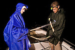 Guido & Katja Westhoff prepare the sea snake for skin sampling. Guido will be doing a positive print out of the skin using a polymer. This polymer will be analyzed in an.electron microscope looking at the skin's ultrastructure - to find out if sea snakes have specific ultrastructures to.enhance swimming efficiency (similar to shark skin).