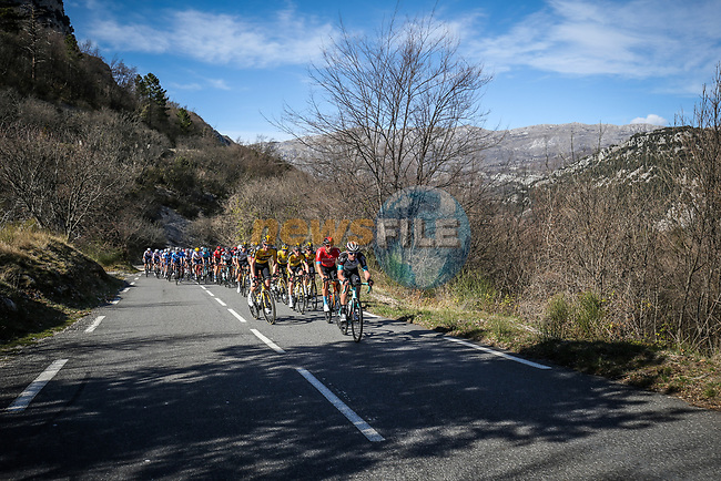 The peloton climb during Stage 6 of Paris-Nice 2021, running 202.5km from Brignoles to Biot, France. 12th March 2021.<br /> Picture: ASO/Fabien Boukla | Cyclefile<br /> <br /> All photos usage must carry mandatory copyright credit (© Cyclefile | ASO/Fabien Boukla)