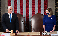 US Vice President Mike Pence stands alongside Speaker of the House Nancy Pelosi as he presides over a joint session of Congress to count the electoral votes for President at the US Capitol in Washington, DC, January 6, 2021.<br /> Credit: Saul Loeb / Pool via CNP/AdMedia