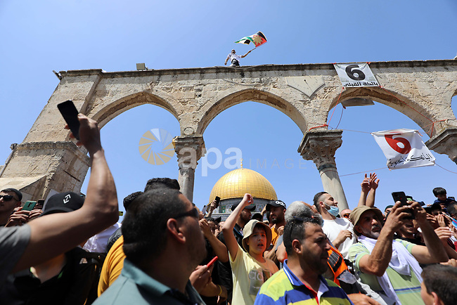 Palestinian worshippers shot slogans after the third Friday of the holy month of Ramadan at Jerusalem's Al-Aqsa Mosque compound, Islam's third holiest site, in support of Jerusalem city and al-Aqsa mousque on April 30, 2021. Photo by Jamal Awad