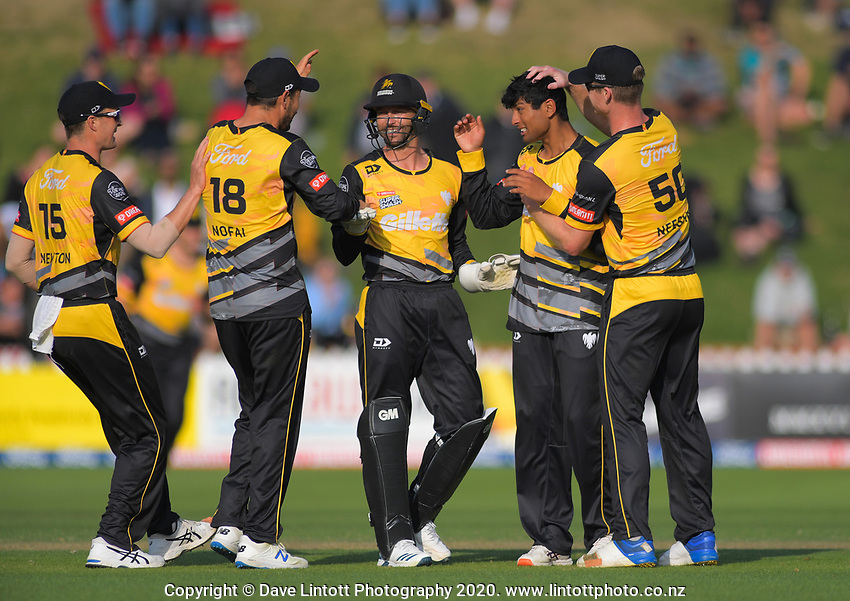 Wellington's Rachin Ravindra celebrates dismissing Northern's Daryl Mitchell during the Dream11 Super Smash cricket match between the Wellington Firebirds and Northern Knights at Basin Reserve in Wellington, New Zealand on Friday, 3 January 2020. Photo: Dave Lintott / lintottphoto.co.nz