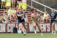 NEWTON, MA - MAY 22: Courtney Weeks #6 of Boston College brings the ball forward as Madison Ahern #10 of Notre Dame defends during NCAA Division I Women's Lacrosse Tournament quarterfinal round game between Notre Dame and Boston College at Newton Campus Lacrosse Field on May 22, 2021 in Newton, Massachusetts.