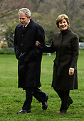 United States President George W. Bush, left, returns to the White House with first lady Laura Bush from his trip to Eastern Europe April 6, 2008 in Washington, DC. Bush couldn't reach an agreement with Russian President Vladimir Putin on putting coverage of a missile defense system in Eastern Europe.  <br /> Credit: Alex Wong / Pool via CNP