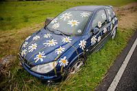 2014 07 08 Artist decorates abandoned car,Llangadog,UK