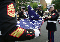 Marine honor gurad, from left Sergeants Randy Smith, Michael Beauchemin, Willam Carter and James DIckson fold the American flag following a ceremony in the Welcome America program at Independence Mall near the Liberty Bell Wednesday July 3, 2002 in Philadelphia. (AP Photo/Brad C Bower)