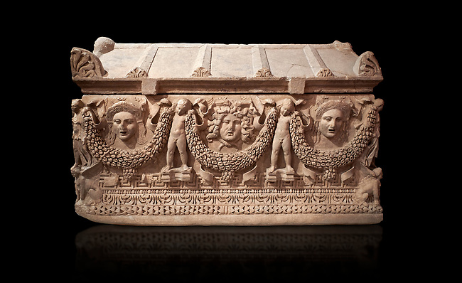 """Picture of Roman relief sculpted Sarcophagus of Garlands, 2nd century AD, Perge. This type of sarcophagus is described as a """"Pamphylia Type Sarcophagus"""". It is known that these sarcophagi garlanded tombs originated in Perge and manufactured in the sculptural workshops of Perge. Antalya Archaeology Museum, Turkey. Against a black background."""