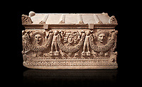 "Picture of Roman relief sculpted Sarcophagus of Garlands, 2nd century AD, Perge. This type of sarcophagus is described as a ""Pamphylia Type Sarcophagus"". It is known that these sarcophagi garlanded tombs originated in Perge and manufactured in the sculptural workshops of Perge. Antalya Archaeology Museum, Turkey. Against a black background."