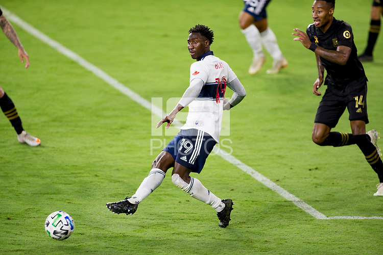 LOS ANGELES, CA - SEPTEMBER 23: Janio Bikel #19 of the Vancouver Whitecaps passes off the ball during a game between Vancouver Whitecaps and Los Angeles FC at Banc of California Stadium on September 23, 2020 in Los Angeles, California.