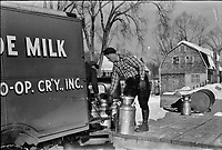 Farmers near Woodstock, Vermont bring their cans of milk to the crossroads early every morning where it is picked up by the coop farmers' truck and is taken to the city, 1940.<br /> <br /> Photo by Marion Post Wolcott.