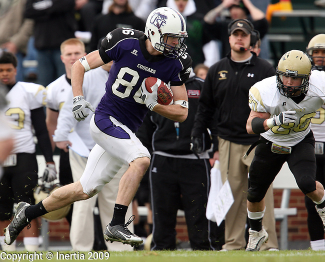 ROME, GA - DECEMBER 19:  Scott LeBrun #86 of the University of Sioux Falls cuts back as Cody Fogle #20 of Lindenwood University closes in during the first half of the NAIA Championship game Saturday afternoon at Barron Stadium in Rome, GA. (Photo by Dave Eggen/Inertia)