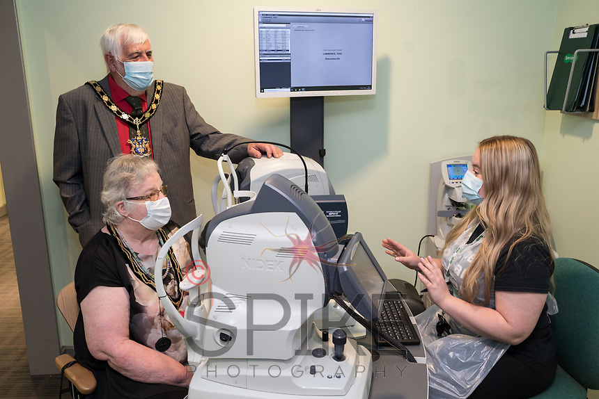 Mayor of Gedling Meredith Lawrence and Mayoress Wendy Lawrence pictured with Clinical Assistant Mia Evans with the new OCT machine at Arnold Specsavers