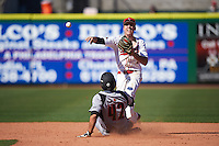 Ball State Cardinals second baseman Seth Freed (1) throws to first base as Colby Fitch (42) slides in during a game against the Louisville Cardinals on February 19, 2017 at Spectrum Field in Clearwater, Florida.  Louisville defeated Ball State 10-4.  (Mike Janes/Four Seam Images)