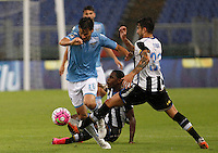 Calcio, Serie A: Lazio vs Udinese. Roma, stadio Olimpico, 13 settembre 2015.<br /> Lazio's Marco Parolo, left, is challenged by Udinese's Duvan Zapata, center, and Panagiotis Kone during the Italian Serie A football match between Lazio and Udinese at Rome's Olympic stadium, 13 September 2015.<br /> UPDATE IMAGES PRESS/Isabella Bonotto