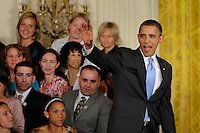President Barack Obama waves as he leaves the East Room after honoring reigning Women's Professional Soccer (WPS) champions Sky Blue FC in the White House in Washington, D. C., on July 01, 2010.