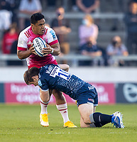 4th June 2021; AJ Bell Stadium, Salford, Lancashire, England; English Premiership Rugby, Sale Sharks versus Harlequins; Ben Tapuai of Harlequins is tackled by AJ Macginty of Sale Sharks