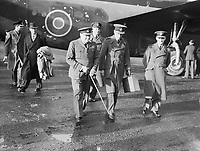 """Royal Air Force Ferry Command, 1941-1943. The Prime Minister, Winston Churchill in RAF uniform, accompanied by Air Chief Marshal Sir Charles Portal, Chief of the Air Staff, leaving Consolidated Liberator """"Commando"""" of No. 24 Squadron RAF at Lyneham, Wiltshire, on their return from the Casablanca Conference. 24 Squadron provided VIP transport for the Prime Minister and Chiefs of Staff during the conference and their subsequent tour of the Middle East. Jan 1, 1943"""