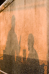 Shilouetted shadows of couple dining and toasting,Elba; Province of Livorno; Italy, Mediterranean Sea;