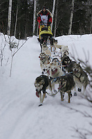 Mitch Seavey on trail shortly after leaving Willow Restart Day.  2005 Iditarod Sled Dog Race