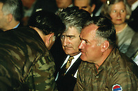 """Yougoslavia. Bosnia. Serbian republic. Bijelina. Radovan Karadzic (L) and General Ratko Mladic (R). Celebration for """"Vidovdan"""" day. Each year on the 28th of June, the serbs celebrate the day of the army. Religious service in the orthodox church. Radovan Karadzic was arrested in Belgrade on 21 July 2008. He was extradited to the Netherlands, and is currently in The Hague, in the custody of the International Criminal Tribunal for the former Yugoslavia. General Ratko Mladic is on the list of the International Criminal Tribunal for the former Yugoslavia (ICTY), based in The Hague in the Nederlands, as a most wanted man for war crimes. © 1995 Didier Ruef"""