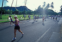 Runners passing Diamond Head in Kapiolani Park at the Honolulu Marathon