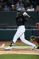 Luis Robert (19) of the Winston-Salem Warthogs follows through on his swing against the Jersey Shore BlueClaws at Truist Stadium on July 21, 2021 in Winston-Salem, North Carolina. (Brian Westerholt/Four Seam Images)