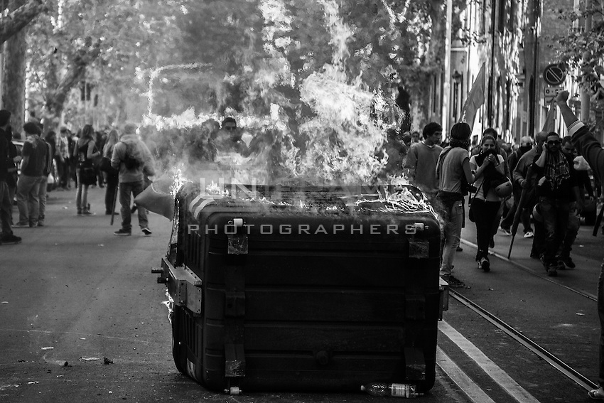 Dumpsters used as barricades are set to fire  during the urban guerilla triggered by violent fringes. Rome, Italy. 15/10/2011