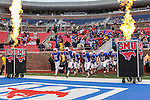 Southern Methodist Mustangs players come out onto the field before the game between the Rutgers Scarlet Knights and the SMU Mustangs at the Gerald J. Ford Stadium in Fort Worth, Texas. Rutgers defeats SMU 55 to 52 in triple OT.