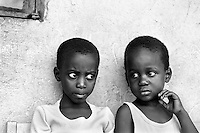 Two young girls are among the lucky few to live in an orphanage in Kampala, Uganda on April 20, 2001.More than 13 million African children have been orphaned by the the AIDS pandemic. Worldwide, more than 20 million people have died since the first cases of AIDS were identified in 1981.