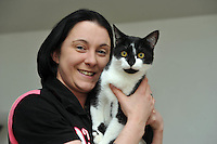 A cat named Oscar has been returned home after going missing since before last Christmas. Oscar was returned from Kent more than 200 miles from his home in Caerau, Cardiff. His owners Danielle, 27, and Rebecca, 28, Spencer are thrilled he has come home. They are urging all pet lovers to have their animals micro chipped . Danielle pictured with Oscar.