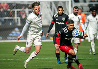 WASHINGTON, DC - FEBRUARY 29: Joseph Mora #28 of DC United moves the ball away from Sam Nicholson #28 of the Colorado Rapids during a game between Colorado Rapids and D.C. United at Audi Field on February 29, 2020 in Washington, DC.