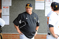 Head Coach Dave Serrano in the dugout  during a  game against the Kentucky Wildcats at Lindsey Nelson Stadium on March 24, 2012 in Knoxville, Tennessee. The game was suspended in the bottom of the 5th with the Wildcats leading 5-0. Tony Farlow/Four Seam Images.