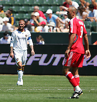 Toronto FC forward (9) Danny Dichio and LA Galaxy midfielder (23) David Beckham during a MLS match. Toronto defeated the LA Galaxy 3-2 at the Home Depot Center Carson, California, Sunday April 13, 2008.