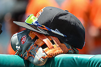 A players gear sits on the rail before the game against the Salt Lake Bees and the Fresno Grizzlies in Pacific Coast League action at Smith's Ballpark on June 14, 2015 in Salt Lake City, Utah.  (Stephen Smith/Four Seam Images)