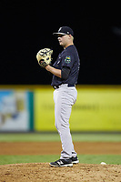 Pulaski Yankees relief pitcher Tyler Johnson (62) looks to his catcher for the sign against the Burlington Royals at Burlington Athletic Stadium on August 25, 2019 in Burlington, North Carolina. The Yankees defeated the Royals 3-0. (Brian Westerholt/Four Seam Images)