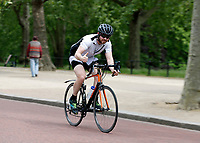 16th May 2020, London, England;  Cyclists cycling towards Buckingham Palace on the mall while not wearing gloves or a mask giving the thumbs up to the photographer