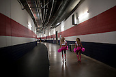 Houston, Texas<br /> October 2, 2011<br /> <br /> Cheerleaders walk the back hallways of the stadium. <br /> <br /> The Houston Texans defeated the Pittsburgh Steelers at the Reliant Stadium 17 to 10.