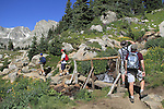 Men hiking in Indian Peaks Wilderness Area, west of Boulder, Colorado, USA. Private guided tours to Indian Peaks. Private photo tours to Indian Peaks.