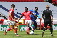 Chuks Aneke of Charlton in possession as Wigan's Cedric Kipre gets ready to make a challenge during Charlton Athletic vs Wigan Athletic, Sky Bet EFL Championship Football at The Valley on 18th July 2020