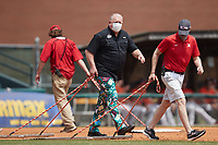 """Richmond Flying Squirrels Vice President and Chief Operating Officer Todd """"Parny"""" Parnell helps drag he field between innings of the game against the Bowie Baysox at The Diamond on July 28, 2021, in Richmond Virginia. (Brian Westerholt/Four Seam Images)"""