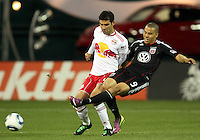 Charlie Davies (9) of D.C. United slides the ball away from Rafa Marquez (4) of the New York Red Bulls during an MLS match at RFK Stadium, in Washington D.C. on April 21 2011. Red Bulls won 4-0.