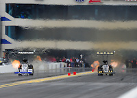 Sept. 17, 2011; Concord, NC, USA: NHRA top fuel dragster driver Antron Brown (left) races alongside Del Worsham during qualifying for the O'Reilly Auto Parts Nationals at zMax Dragway. Mandatory Credit: Mark J. Rebilas-US PRESSWIRE