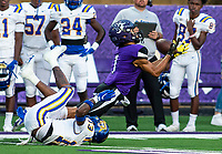 Phillip Sategna (1) of Fayetteville nearly makes catch with a pass interference penalty by Jaylen Pettus (13) of North Little Rockat Harmon Field , AR, on Friday,September 10, 2021 / Special to NWADG David Beach
