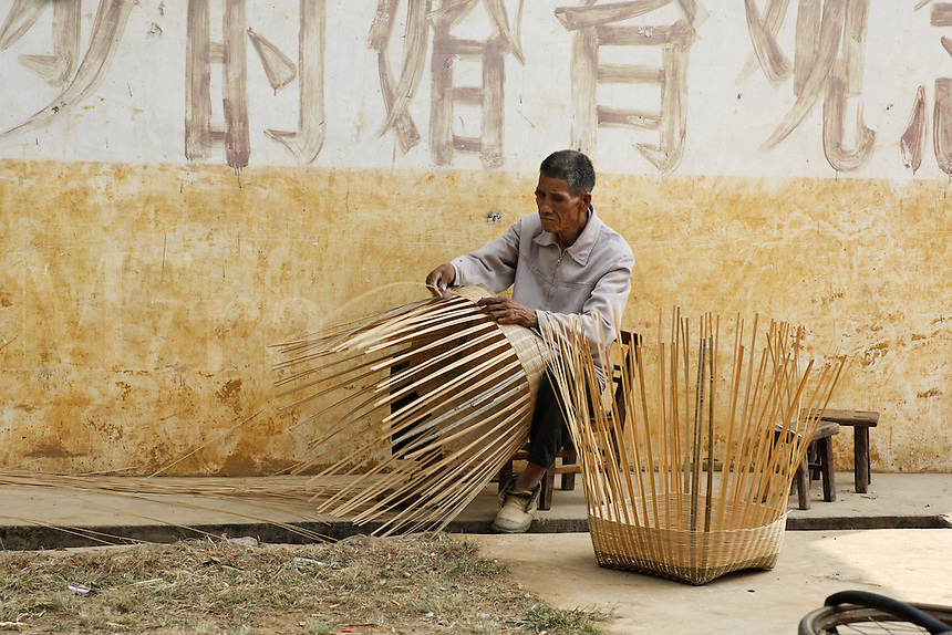 Man weaving large baskets, Yulang River valley, Yangshuo, Guanxi, China