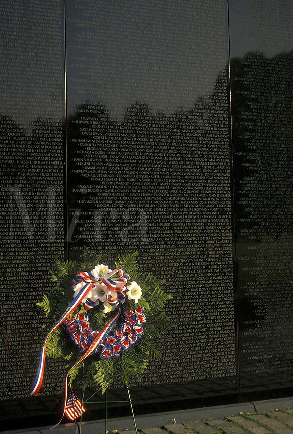 AJ4229, Vietnam Veterans Memorial Wall, Washington, Vietnam Memorial, DC, District of Columbia, capital city, A wreath is placed by a loved one who served and died in the Vietnam War on the black granite wall of the Vietnam Veterans Memorial in the nation's capital Washington, D.C.