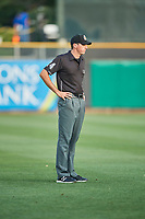 Third base umpire Nate Tomlinson handles the calls on the bases during the game between the Salt Lake Bees and the El Paso Chihuahuas at Smith's Ballpark on August 13, 2018 in Salt Lake City, Utah. Salt Lake defeated El Paso 4-3. (Stephen Smith/Four Seam Images)