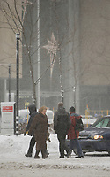 Montreal (Qc) CANADA - December 3rd 2007-.Pedestrian walk in front of Place Ville-Marie on rene-Levesque boulevard while .Heavy snow fall on Montreal, more than 30cm is expected...photo : (c) ROUSSEL - Images Distribution.