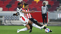 Michael Ihiekwe of Rotherham tries to block a cross from Brentford's Ivan Toney during Brentford vs Rotherham United, Sky Bet EFL Championship Football at the Brentford Community Stadium on 27th April 2021